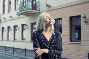 woman-walking-and-blowing-bubble-gum
