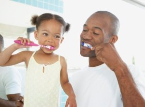 Pediatric-Dental-Assistant-School-Brushing-Teeth-With-Child